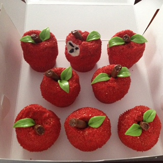 Cupcakes decorated to look like apples.