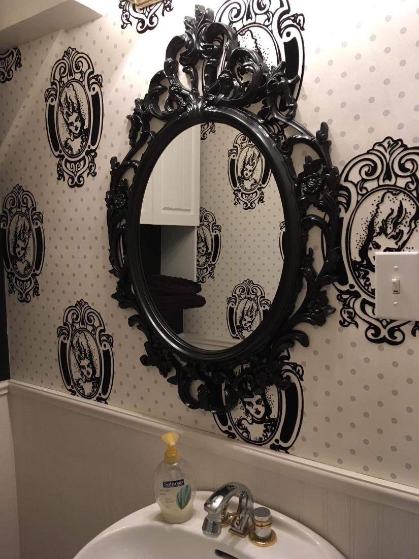 I love this wallpaper and it looks amazing in the powder room.