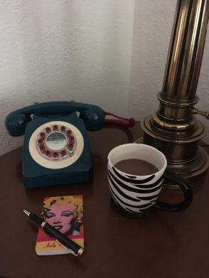In the living room is a vintage reproduction telephone, it makes all phone calls special.
