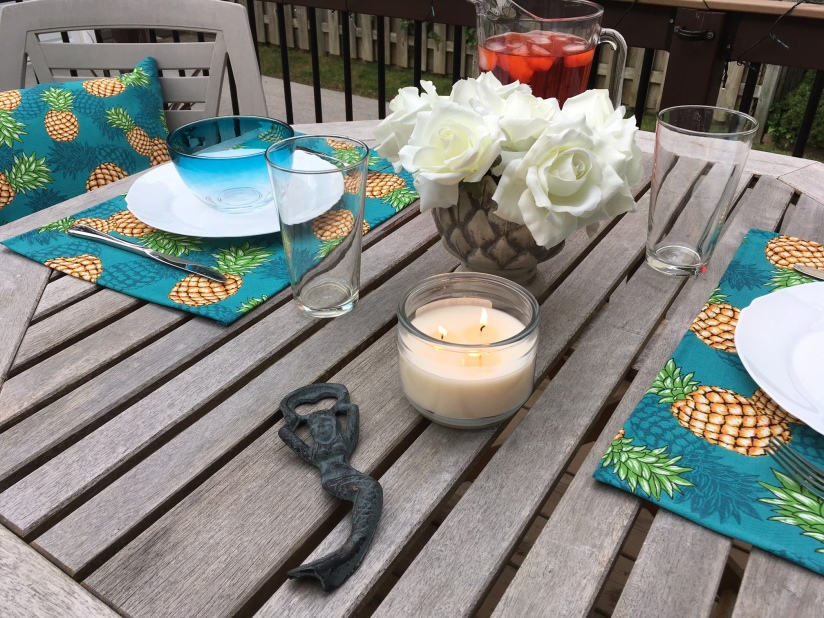 The pillows and placemats add a lot of colour to the table.