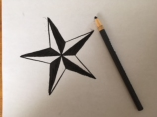 Trace the star using a charcoal pencil.