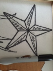 Trace the nautical star outline in marker.