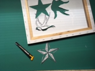 Using the same technique as the sparrows, cut out the nautical star template.
