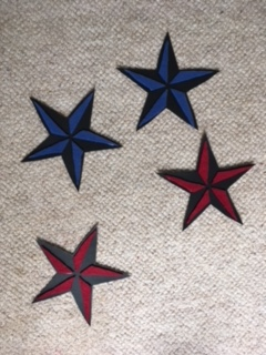 These nautical star patches are ready to be glued to the pillowcase.