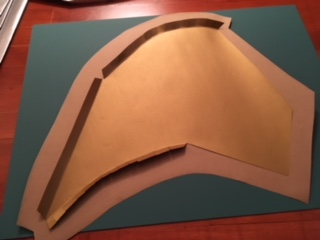 With the notches cut, the tabs folded and the paper glued to the bristol board, it's ready for wrapping.