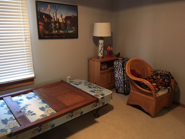 This is what the spare room has looked like for the past year. Usually the box spring has fabric lying all over it.