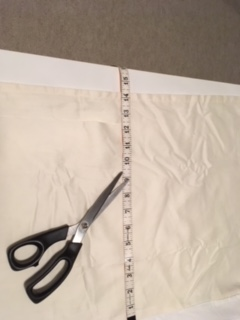 Measure from the top of the bedskirt to the floor and transfer this measurement to the skirt once you have it off the bed.