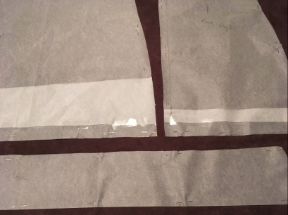 Once the pattern is finished label the pieces and pin them to the fabric for cutting.
