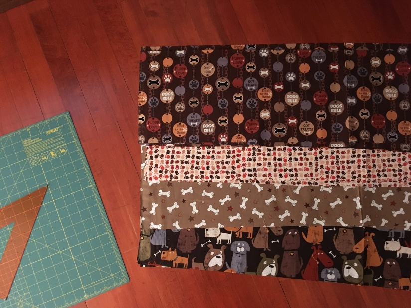 I have selected four fabrics of a similar colour story for this dog lover's quilt.