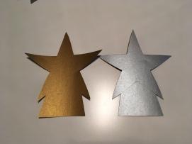 After the templates have been drawn out, cut out each star shape.