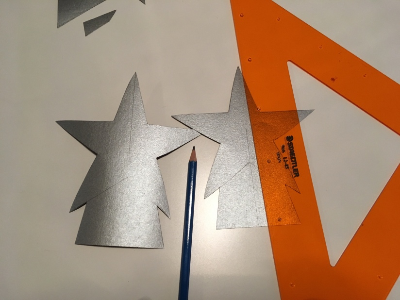 Once the stars have been cut out, use a straight edge to draw on the lines where the cuts need to be made.