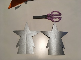 After the cuts have been made the pieces should slide together to create a three dimensional star.