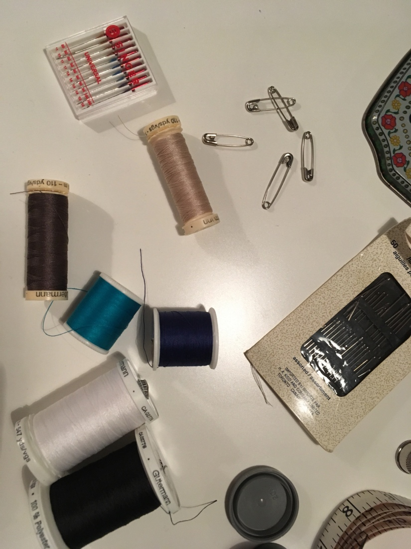 Needles, thread, pins are really the basics.