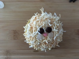 Rolling the cupcake in the coconut and then filling in any spaces by hand help create a mane.