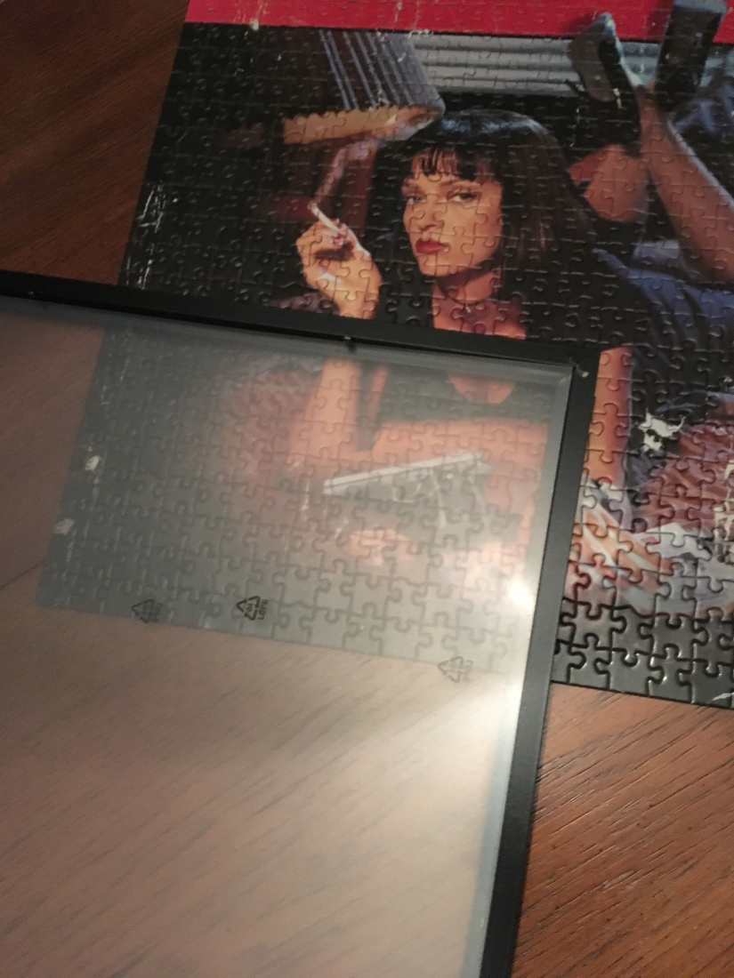 I've got the back off the frame. I'm going to remove the plexiglass and the protective backing from one side.