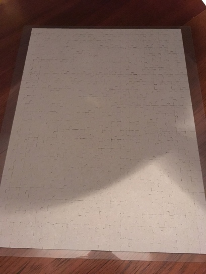 With the back of the puzzle exposed, I'm going to tape the back of the puzzle to hold it together.
