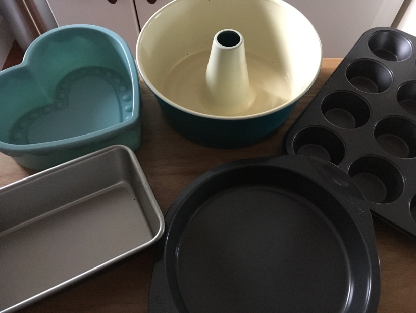 I have a little collection going of baking pans, but to get started a cupcake tray and a round or square pan would probably be enough.
