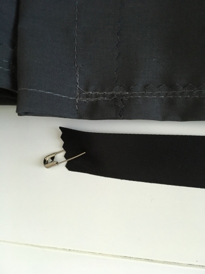 The easiest way to get the ribbon inserted into the bag is to attach a safety pin to one end and use that to guide the ribbon through the fabric and out the other end.